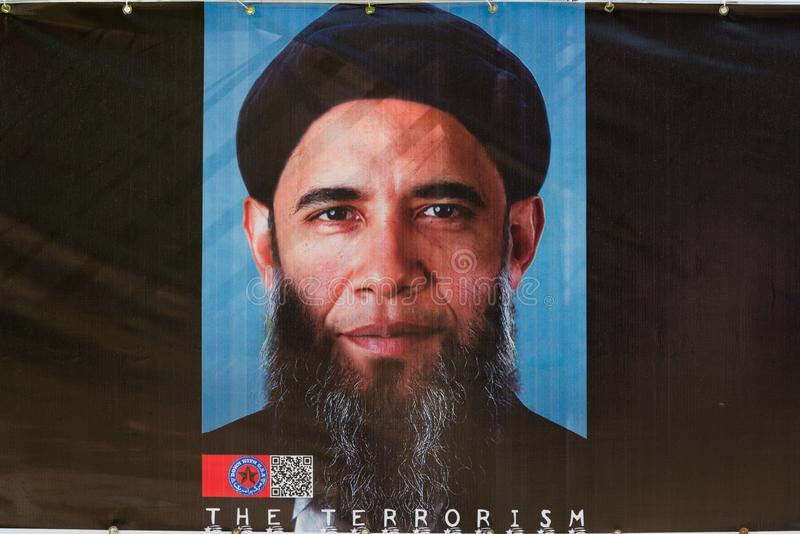 Visualización del presidente anterior de los E.E.U.U. Barack Obama como terrorista con una barba mostrada en la guarida de los E. fotos de archivo libres de regalías