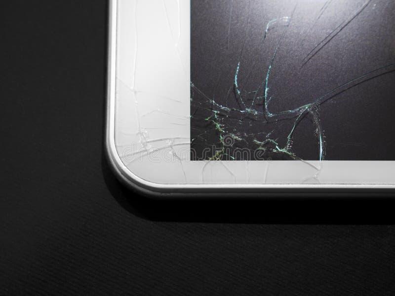 Visualización quebrada Tableta de cristal agrietada, dispositivo imagenes de archivo