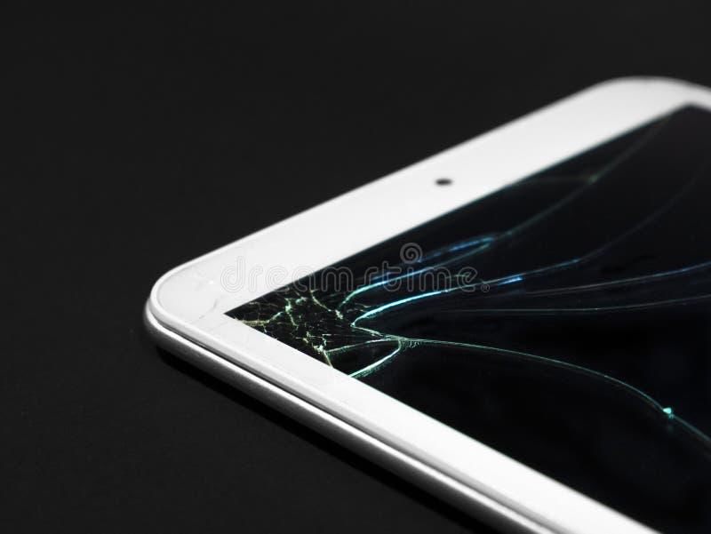 Visualización quebrada Tableta de cristal agrietada, dispositivo imágenes de archivo libres de regalías