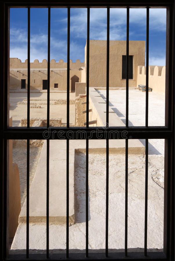 Visualizing from a window inside the Riffa Fort. Riffa fort is historical fort built by Shaikh salman bin Ahmed Al Khalifa in 1812 on the remains of an old 17th royalty free stock photography