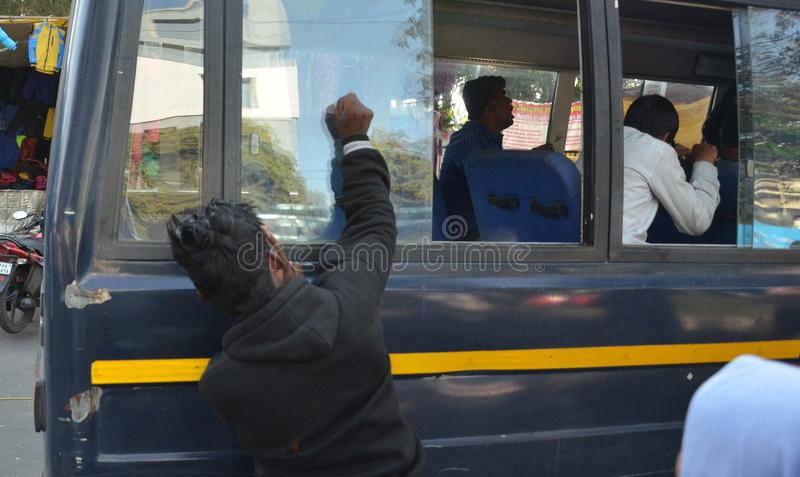 Visually impaired students braking window glasses of police buses royalty free stock photography