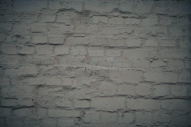 Vit bakgrund f?r tegelstenv?gg i lantligt rum arkivbilder