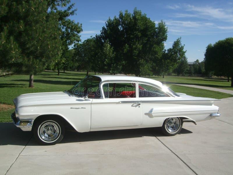 Vit Chevy för USA-tappningbil 1960 arkivfoto