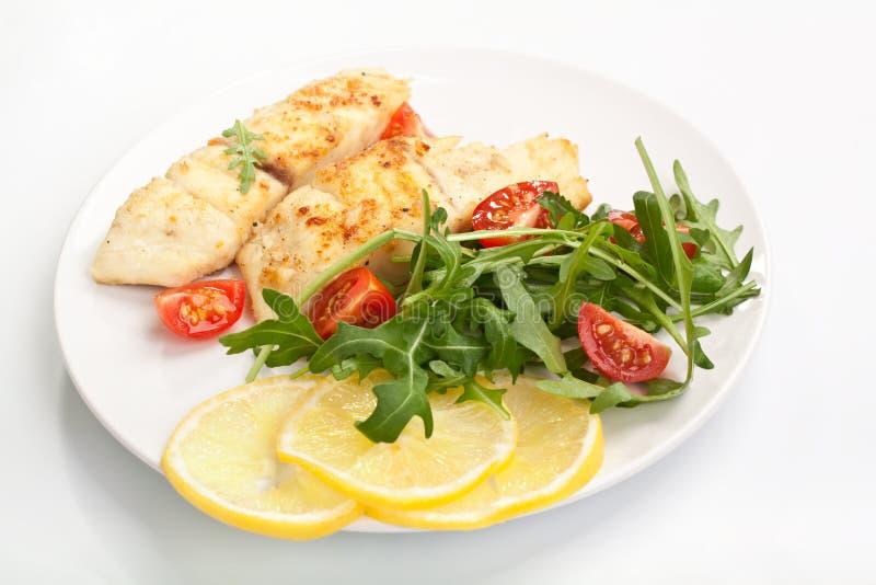 Vit fisk med Rocket Salad royaltyfri fotografi