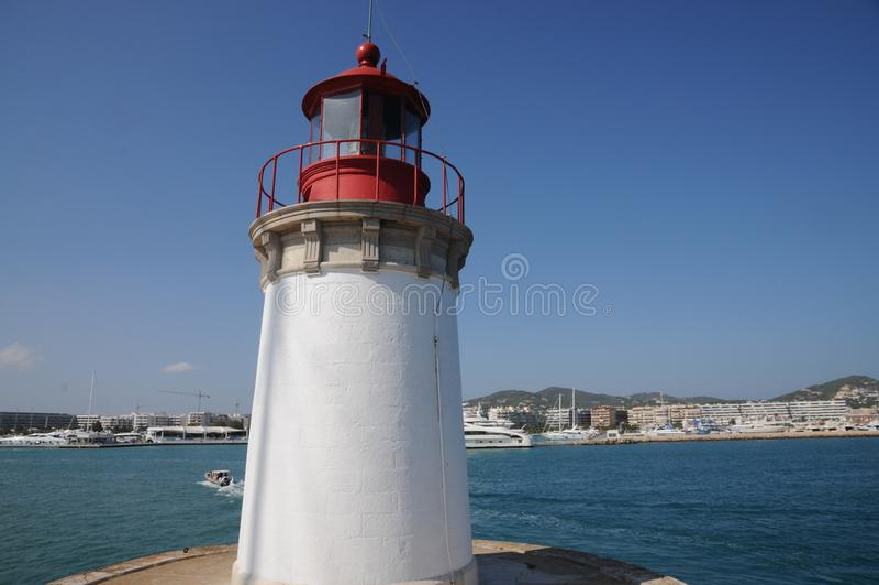 Vit fyr Es Botafoc i Ibiza Balearic Island Soain fotografering för bildbyråer
