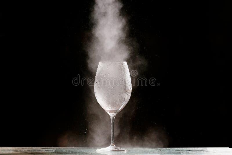 Vit gas i ett exponeringsglas arkivfoton