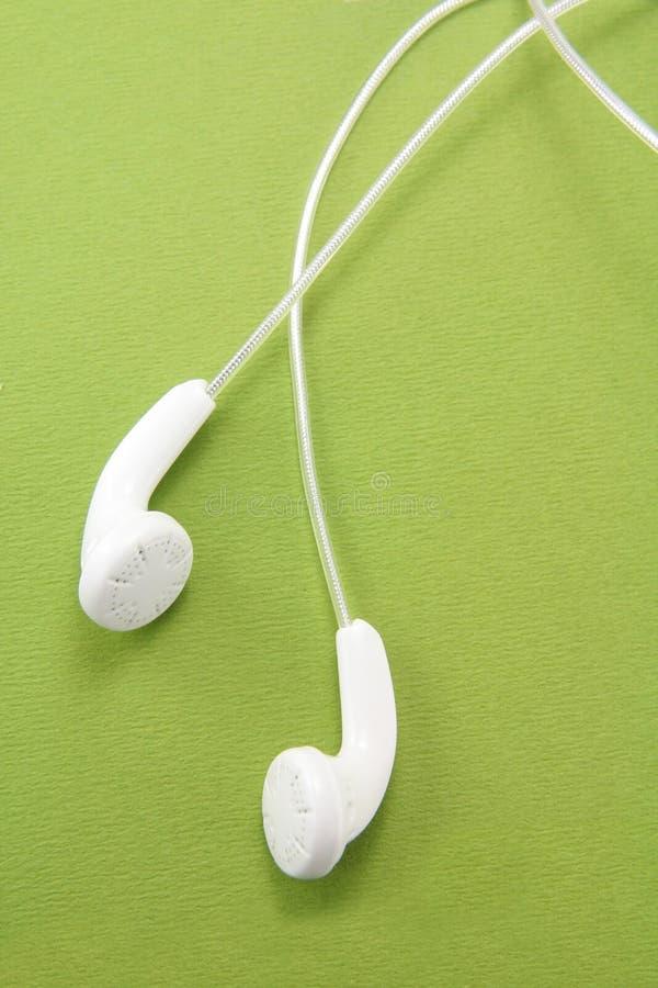 vit hörlurar fotografering för bildbyråer