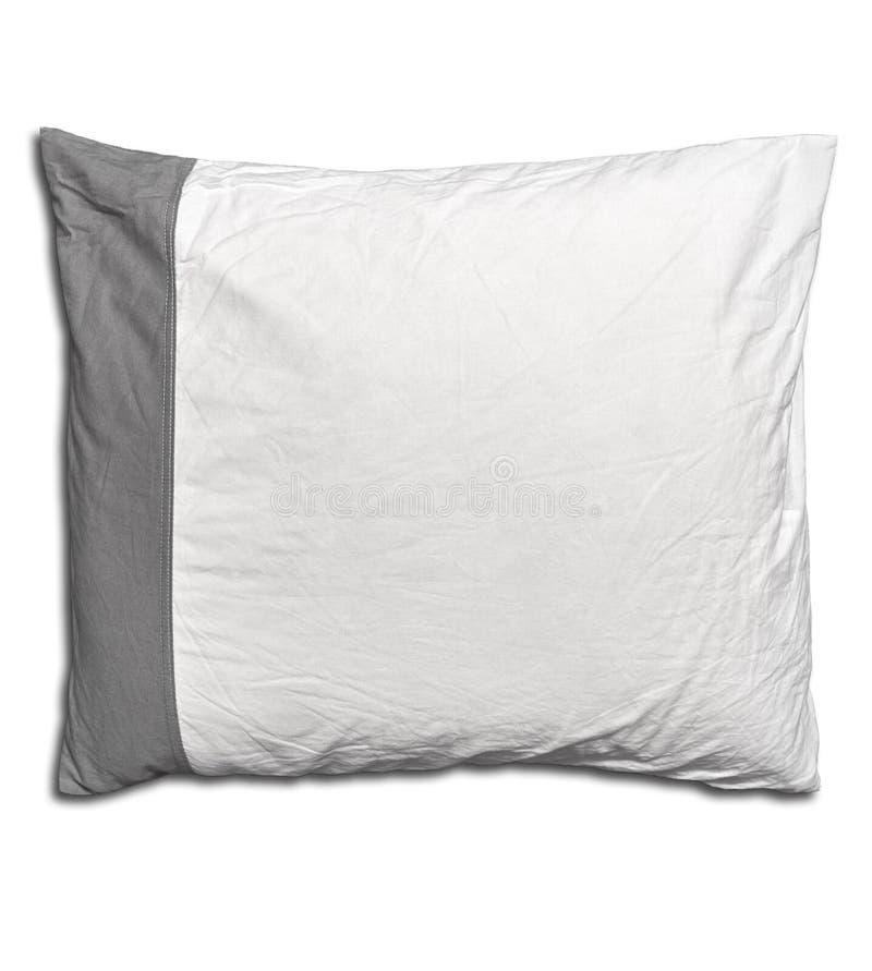 Vit kudde för grå färger och av en isolerad säng arkivbild