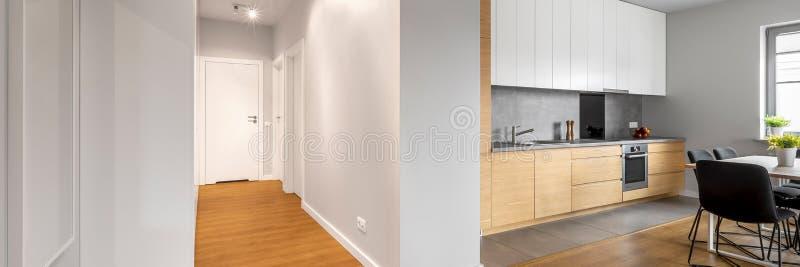 Vit lägenhet med ädelträgolv royaltyfria foton