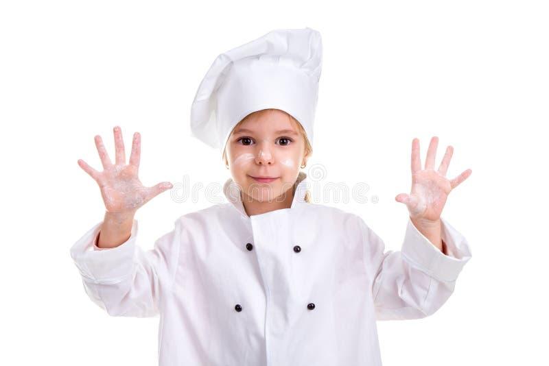 Vit likformig för flickakock som isoleras på vit bakgrund Pudrade framsidan och gömma i handflatan upp Se le på kameran arkivfoto