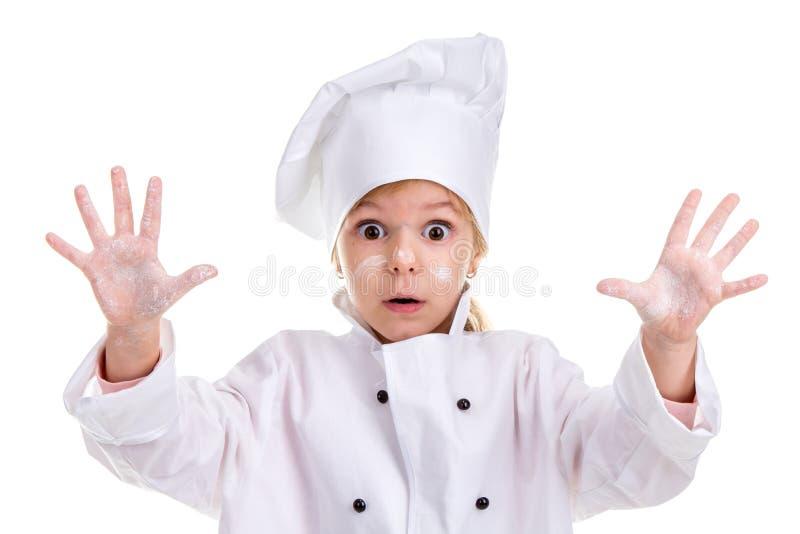 Vit likformig för flickakock som isoleras på vit bakgrund Pudrade framsidan och gömma i handflatan upp Se skrämt på kameran Lands arkivfoto