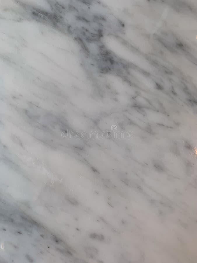 Vit mable textur f?r bakgrund fotografering för bildbyråer