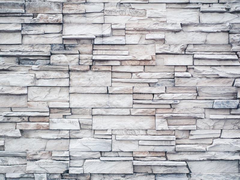 Vit marmorerar stentegelstenväggen arkivbild