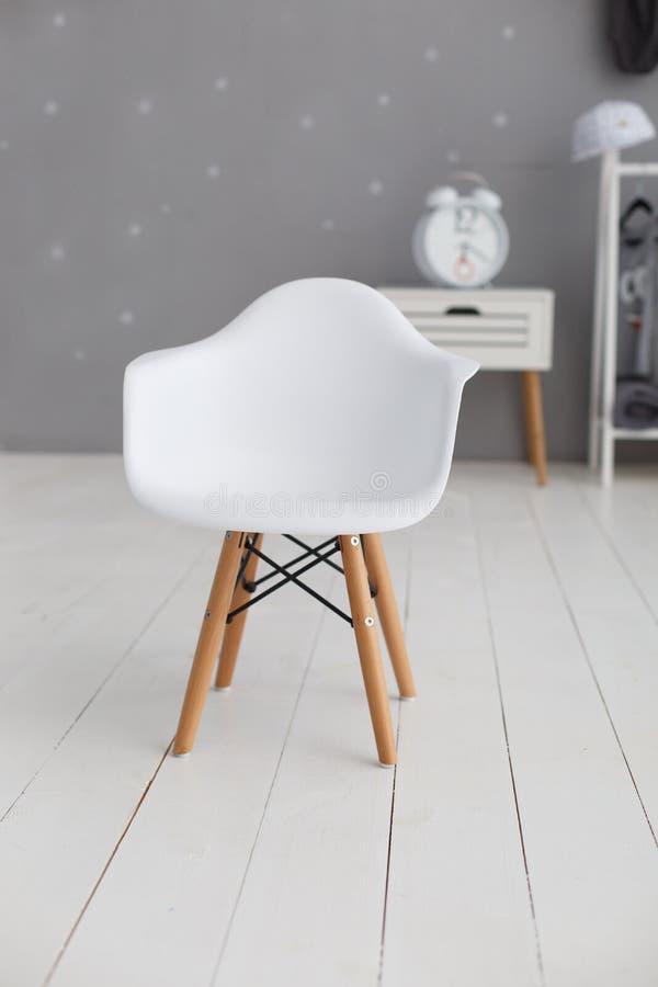 Vit modern plast- stol royaltyfria bilder