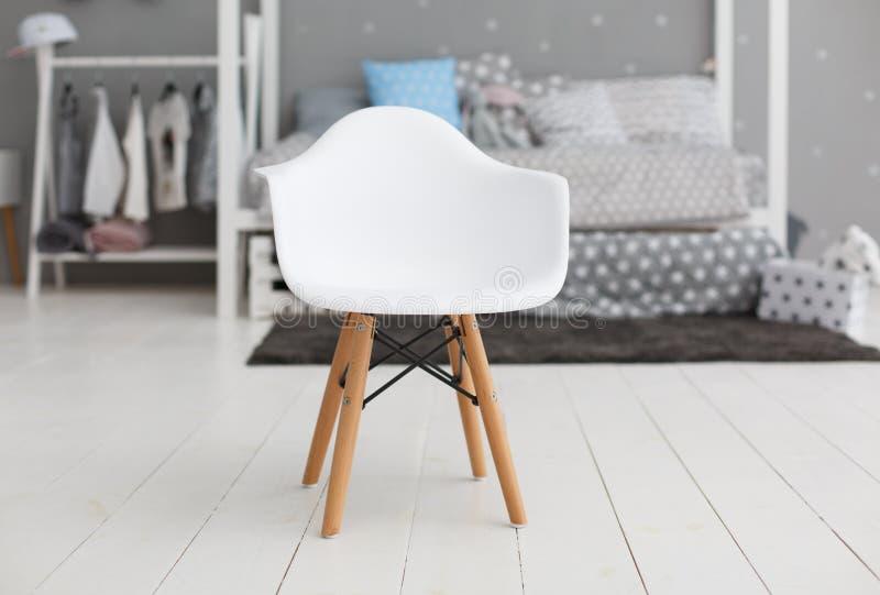 Vit modern plast- stol arkivbild