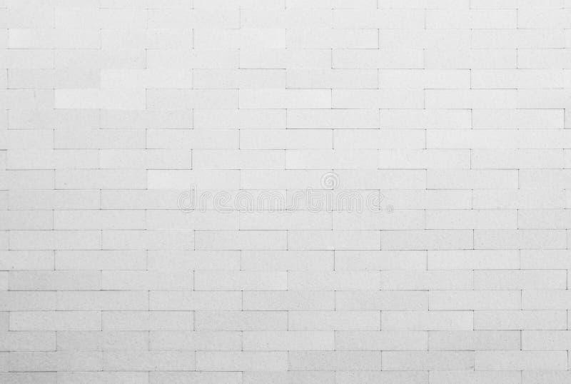 Vit och grå färger fotoet eller tegelstenen för hög upplösning för tegelplattavägg det verkliga arkivfoto