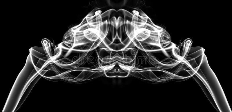 Vit rök i formen av ett diagram royaltyfria bilder