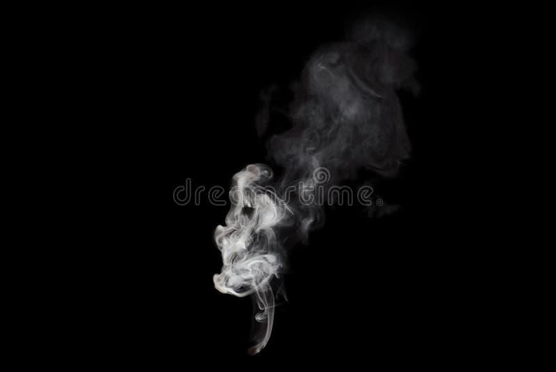 Vit rök som isoleras på svart arkivbilder