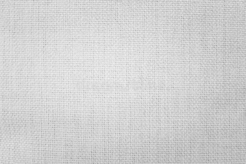 Vit säckvävtexturbakgrund Väva textilmaterial eller den tomma torkduken royaltyfri bild