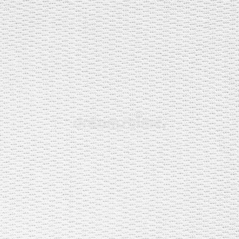 Vit sömlös kanfastygbakgrund arkivfoton
