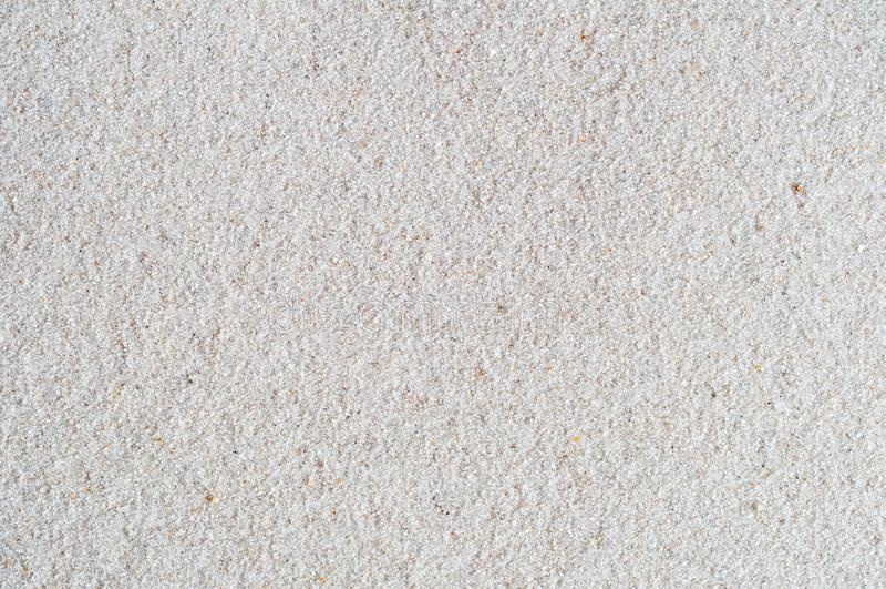 Vit sandbakgrund med sandig textur arkivbild