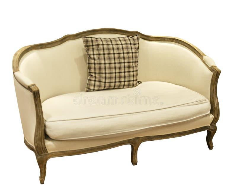 Vit soffa i en romantisk stil royaltyfria foton