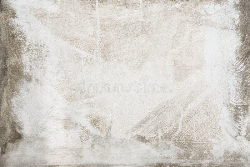 Vit som målas på väggen för grå färgbetongtextur abstrakt bakgrund royaltyfri foto