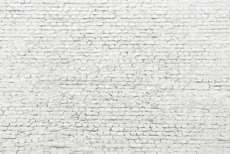Vit tegelstenvägg, gammal yttersidatextur av stenkvarter royaltyfria bilder