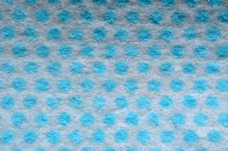 vit torkduk i blåa ärtor royaltyfria foton