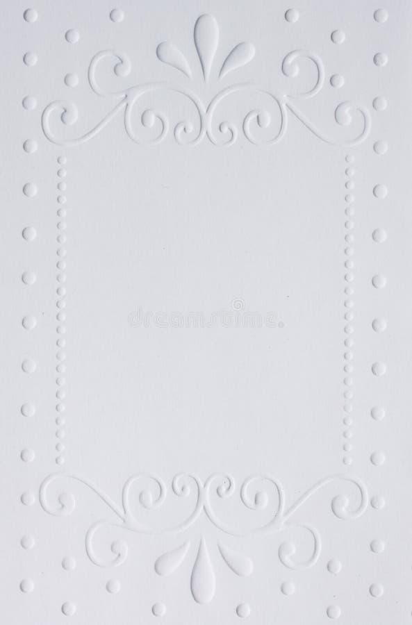 Vit utföra i relief papper arkivbild