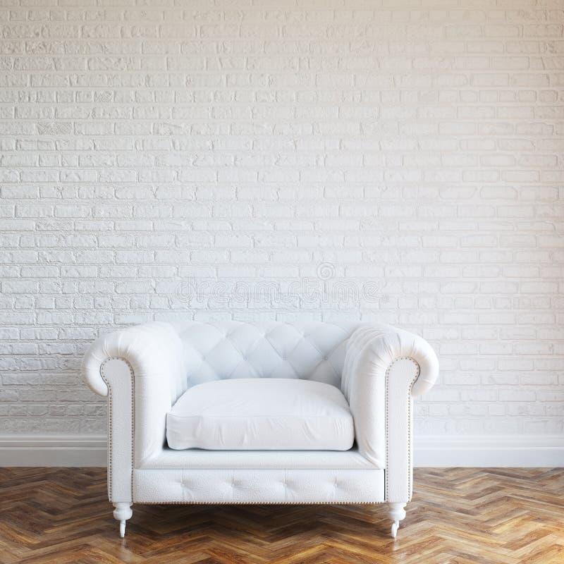 Vit väggtegelsteninre med den klassiska läderfåtöljen royaltyfri fotografi
