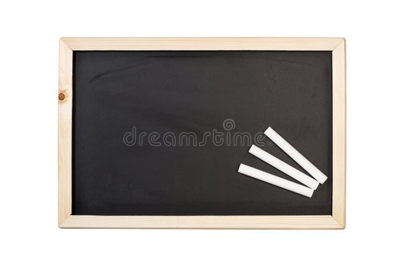 Vita chalks och en svart tavla royaltyfria bilder
