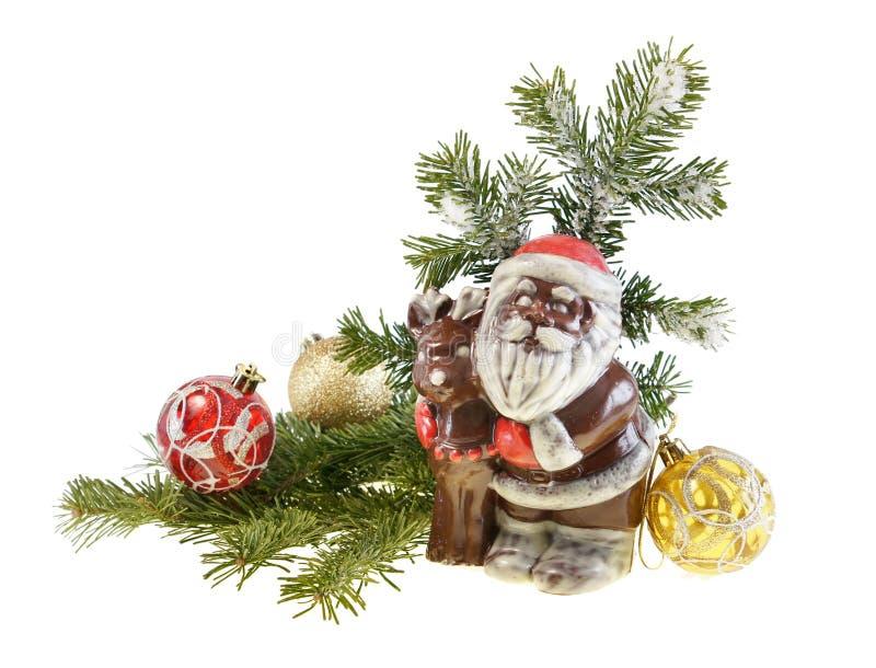 Vita di nuovo anno ancora con un cioccolato il Babbo Natale fotografie stock