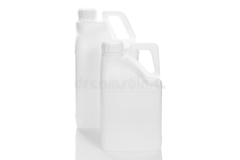 Vita flaskor på vit bakgrund royaltyfri fotografi