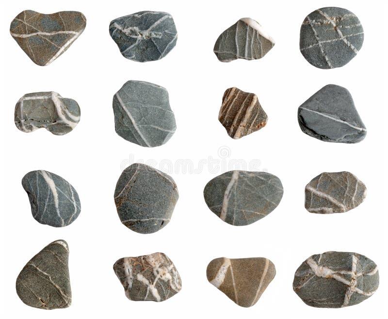vita isolerade pebbles för strand samling royaltyfria foton