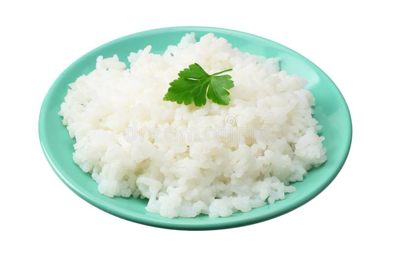 Vita ris i den blåa bunken som isoleras på vit bakgrund arkivbilder