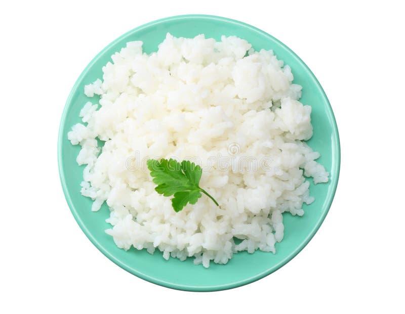 Vita ris i den blåa bunken som isoleras på vit bakgrund Top beskådar royaltyfri bild
