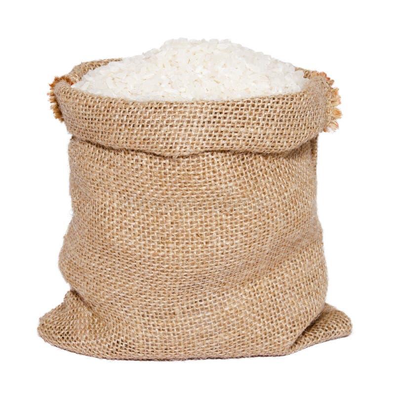 Vita ris i säckvävsäck royaltyfria foton