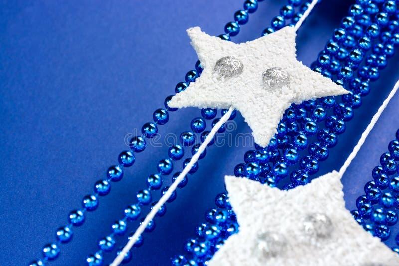Download Vita stjärnor på blue arkivfoto. Bild av closeup, stjärna - 27286614