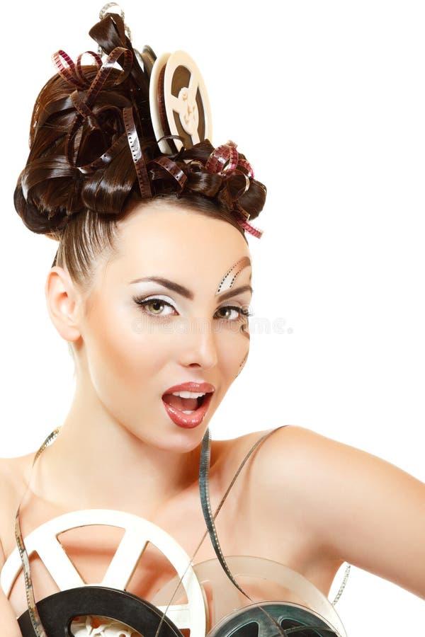 Vitage kvinna med härligt smink och frisyren för konstfilmfilm royaltyfria bilder