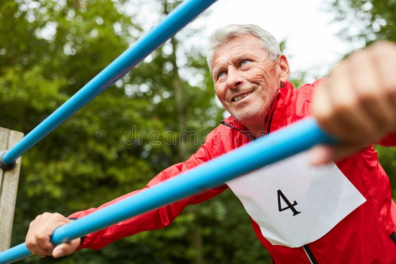 Senior man is doing a fitness exercise stock images