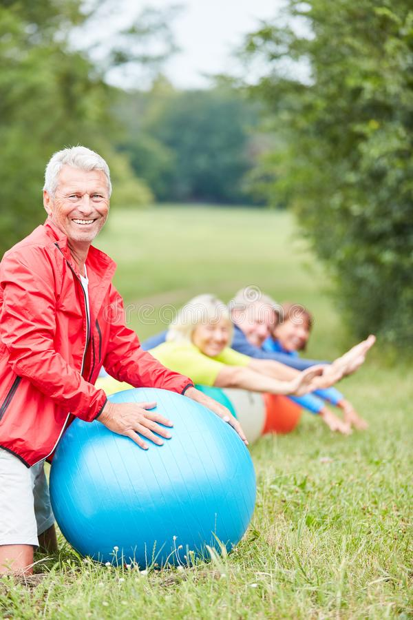 Free Vital Senior With Exercise Ball In The Park Stock Photo - 153863680