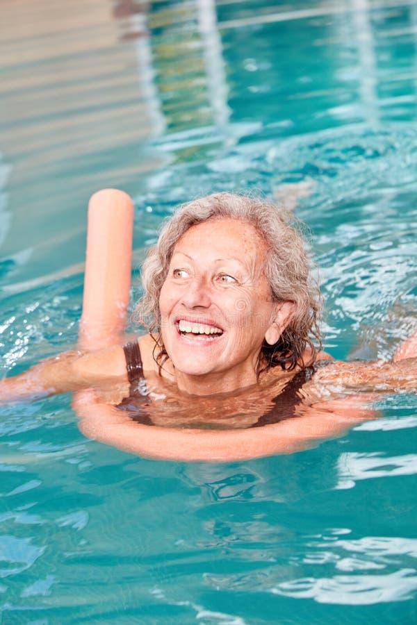 Vital senior woman is learning to swim royalty free stock photo