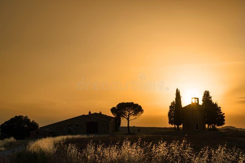 Vitaleta Chapel at sunset, Tuscan landscape near San Quirico d`Orcia, Siena, Tuscany Italy royalty free stock photo