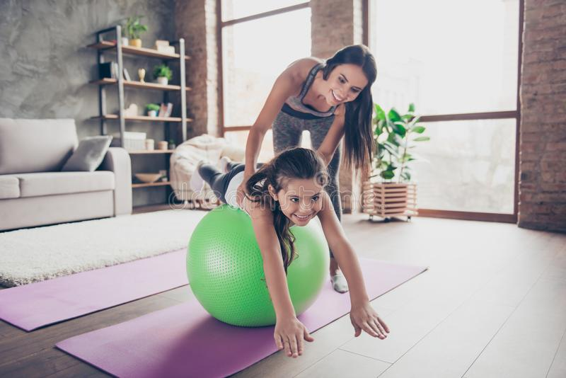 Vitality wellness wellbeing leisure concept. We are strong together! Small nice charming lovely sweet preteen girl is doing stock photos