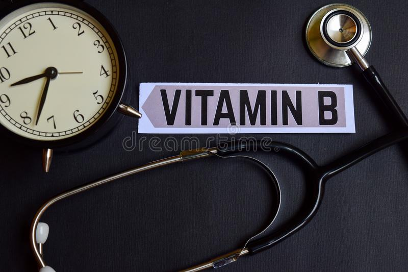 Vitamin B on the paper with Healthcare Concept Inspiration. alarm clock, Black stethoscope. stock photos
