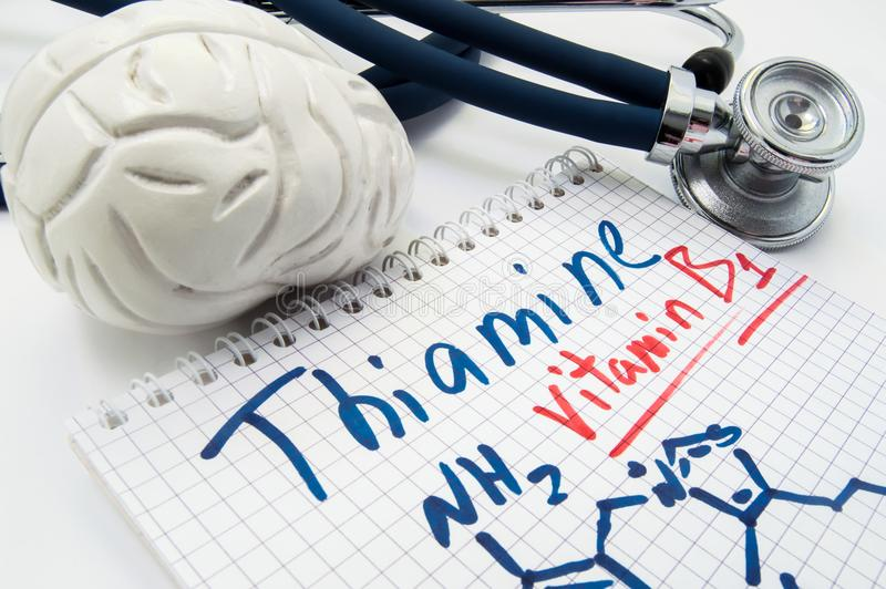 Vitamin B1 Thiamin concept photo. Stethoscope and brain figure lies next to inscription Vitamin B1 thiamin and vitamin chemical fo royalty free stock photo