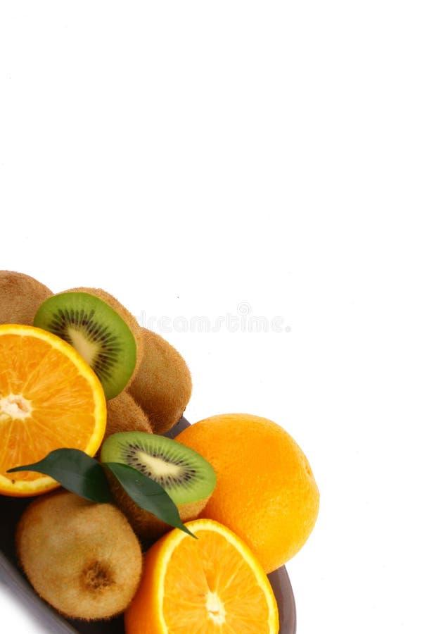 Vitamin Ckiwis und -orange lizenzfreies stockfoto
