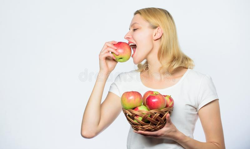 Vitamin diet. Nature. farming green life. healthy food. autumn harvest. Spring seasonal fruit. Happy woman eating apple. Orchard, gardener girl with apple stock photography