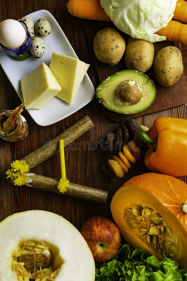 Vitamin A in food, Natural products rich in vitamin A as pepper, carrot, pumpkin, apple, potato, cabbage, avocado,dried apricots,. Melon, anchovy, yellow cheese stock photo
